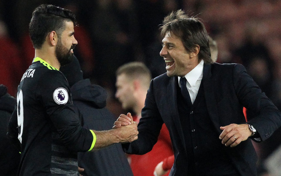 Chelsea's Italian head coach Antonio Conte (R) reacts as he congratulates Chelsea's Brazilian-born Spanish striker Diego Costa following the English Premier League football match between Middlesbrough and Cheslea at Riverside Stadium in Middlesbrough, northeast England on November 20, 2016. Chelsea won the match 1-0. / AFP PHOTO / Lindsey PARNABY /