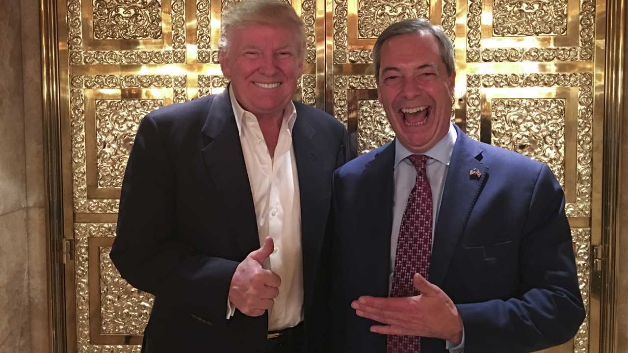 """A handout picture released by the UK Independence Party (UKIP) on November 12, 2016 shows UKIP leader Nigel Farage (R) posing with US President-elect Donald Trump during their meeting at Trump Tower in New York. / AFP PHOTO / UKIP / Andy WIGMORE / RESTRICTED TO EDITORIAL USE - MANDATORY CREDIT """" AFP PHOTO / UKIP / ANDY WIGMORE """" - NO MARKETING NO ADVERTISING CAMPAIGNS - DISTRIBUTED AS A SERVICE TO CLIENTS"""