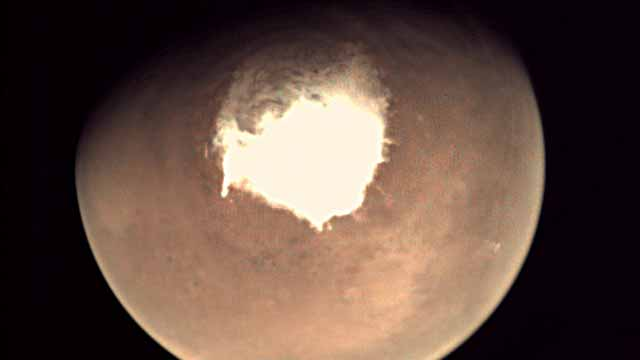 """(FILES) This file handout picture released on October 16, 2016 by the European Space Agency (ESA) shows planet Mars as seen by the webcam on ESA's Mars Express orbiter, as another mission, ExoMars, is about to reach the Red Planet. The tiny European craft Schiaparelli despatched to Mars for a trial touchdown on October 19, 2016, """"crashed"""" into pieces on the Red Planet's surface instead due to """"a navigation software problem"""" told A NASA photograph of the intended landing site confirmed the Schiaparelli craft, missing for two days, had """"crashed on the surface of Mars"""", told the AFP European Space Agency mission manager Thierry Blancquaert. HO / EUROPEAN SPACE AGENCY / AFP"""