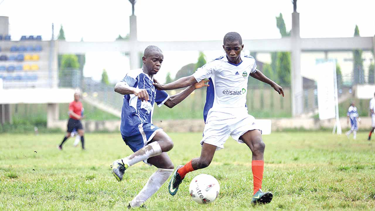 FOSLA Academy, Abuja, and Edo State team battling for honours at the on-going Etisalat U-15 Schools Cup holding In Lagos. PHOTO: FEMI ADEBESIN-KUTI.