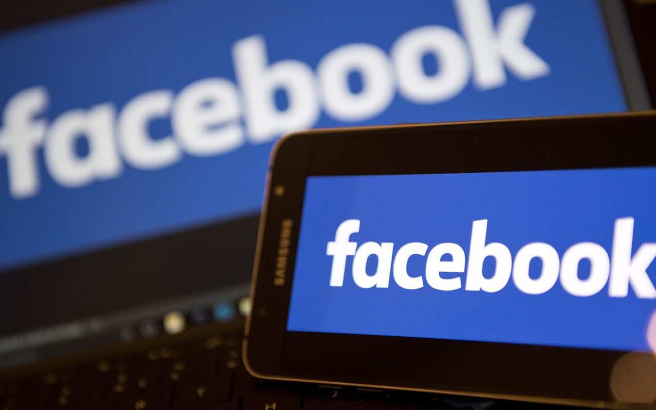 Facebook logos AFP PHOTO / Justin TALLIS
