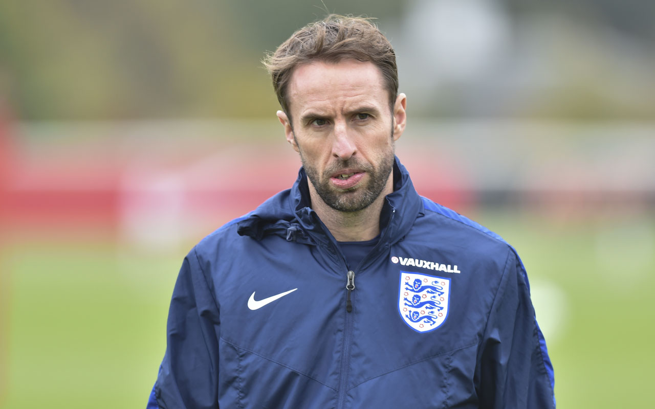 (FILES) This file photo taken on November 14, 2016 shows England interim manager Gareth Southgate as he leads a training session at Tottenham's training ground in north London, ahead of their international friendly football match against Spain. The Football Association announced that Southgate had been appointed as the new England manager on November 30, 2016. / AFP PHOTO / OLLY GREENWOOD /