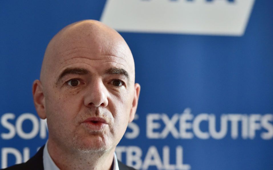 FIFA President Gianni Infantino addresses journalists during a press briefing at a hotel in Roissy-en-France, north of Paris, on November 23, 2016. FIFA president Gianni Infantino wrapped up the first of 11 executive meetings with federation representatives today by saying those gathered in Paris were all in favour of expanding the World Cup. A 48-team format would see the 16 group winners of a qualifying round automatically book a place in the tournament, while an additional 32 teams would compete in a new pre-tournament play-off. / AFP PHOTO / CHRISTOPHE ARCHAMBAULT