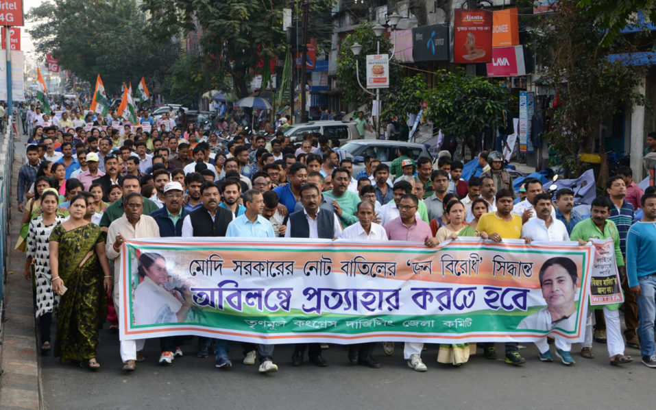 Indian activists of the Trinamool Congress (TMC) shout slogans against Prime Minister Narendra Modi during a protest meeting in Siliguri on November 24, 2016. TMC organised the protest rally against the government's shock decision to withdraw the two largest denomination notes from circulation. / AFP PHOTO / DIPTENDU DUTTA
