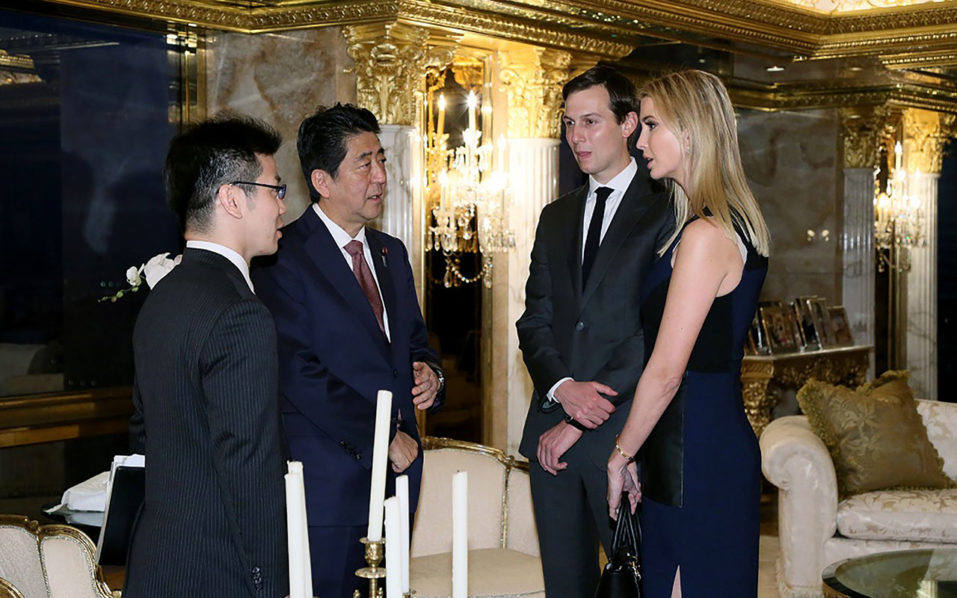 This handout picture, released by Japan's Cabinet Secretariat on November 18, 2016 shows Japanese Prime Minister Shinzo Abe (2nd L) being welcomed by Ivanka Trump (R) and her husband Jared Kushner (2nd R) during a meeting with US President-elect Donald Trump (not pictured) in New York. Abe voiced confidence on November 17 about Trump as he became the first foreign leader to meet the US president-elect, who was narrowing in on cabinet choices. / AFP PHOTO / Cabinet Secretariat / HO /