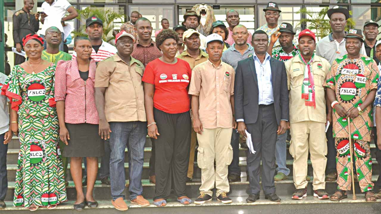 Enug State Commissioner for Labour and Productivity, Barrister Emeka Okeke (third right) representing Governor Ifeanyi Ugwuanyi; Nigerian Labour Congress (NLC) Head of Industrial Relations and Organisation, Comrade Emmanuel Ugboaja (fourth right); State chairman of NLC, Comrade Virginus Nwobodo (second right) his Ebonyi State counterpart, Comrade Ikechukwu Nwafor (third left); Deputy Chairperson, National Women Commission, NLC, Comrade Oby Eze (fourth left) and other labour leaders during a march to Enugu Govt House to mark the 67th anniversary of the massacre of coal miners in Enugu, yesterday