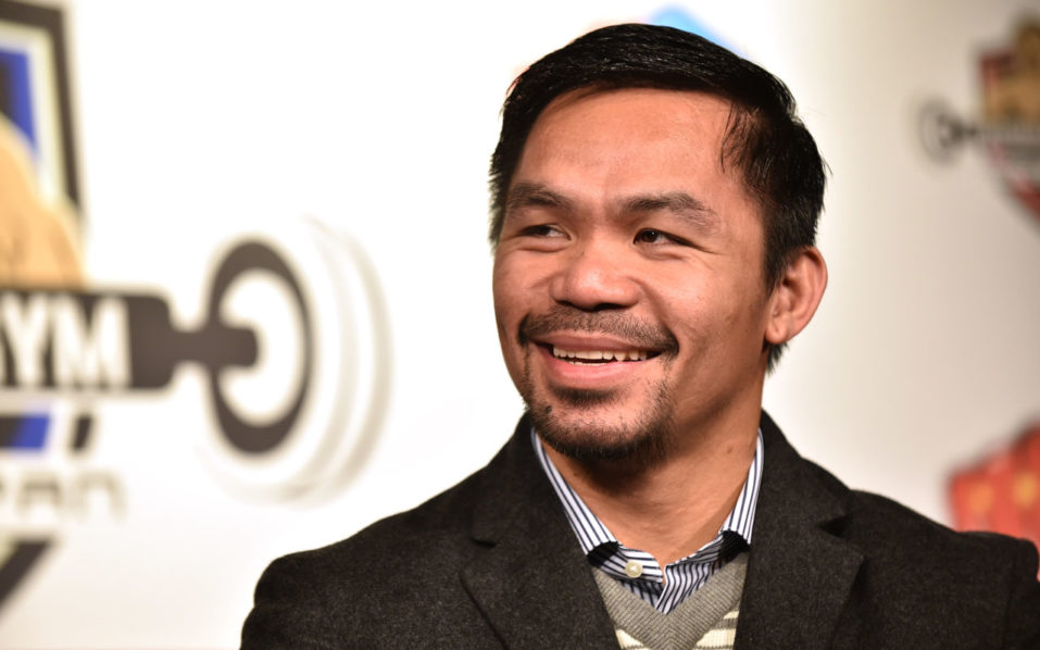 """WBO welterweight world champion Manny Pacquiao attends a press conference at his boxing gym in Tokyo on November 25, 2016. WBO welterweight world champion Manny Pacquiao on November 25 kept alive hopes for a rematch with Floyd Mayweather, saying the epic clash was """"possible"""" but only if his arch rival returns to the ring. / AFP PHOTO / KAZUHIRO NOGI"""