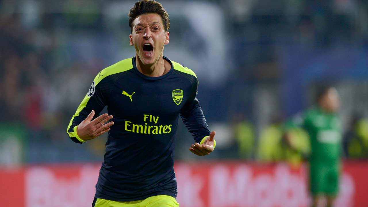 Arsenal's German midfielder Mesut Ozil celebrates after scoring a goal during the UEFA Champions League Group A football match between PFC Ludogorets and Arsenal, on November 1, 2016 at the Vassil Levski stadium in Sofia. NIKOLAY DOYCHINOV / AFP