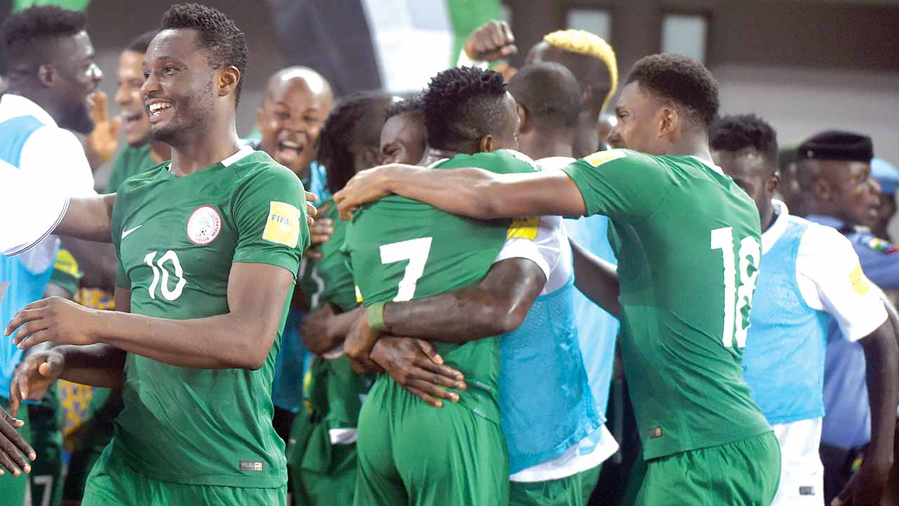 Super Eagles' Captain, John Obi Mikel (left), celebrating with his teammates after leading Nigeria to a 3-1 defeat of Algeria in a Russia 2018 World Cup qualifier played in Uyo. PHOTO: AFP.