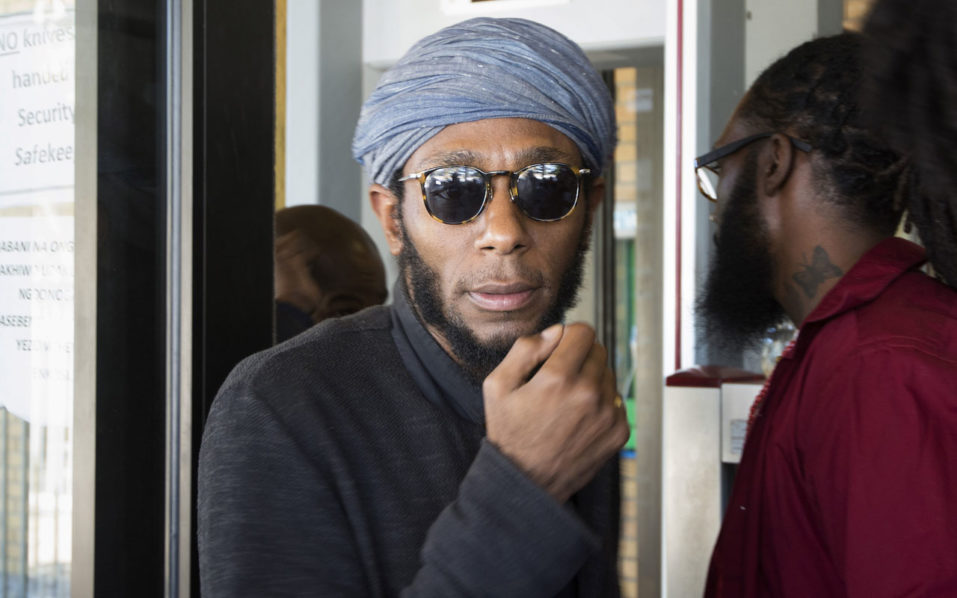 Us hip hop artist and actor, Yasiin Bey, popularly known as Mos Def, walking out of the Bellville Magistrates Court, refusing to take off his turban as requested by security, before being due to appear for contravening South African immigration laws, in Cape Town. Mos Def who broke South Africa's immigration laws by using a 'world passeport', was allowed to leave South Africa on November 22, 2016 but will be considered as an 'undesirable' in the country, according to the South African Interior Ministry / AFP PHOTO / Rodger BOSCH
