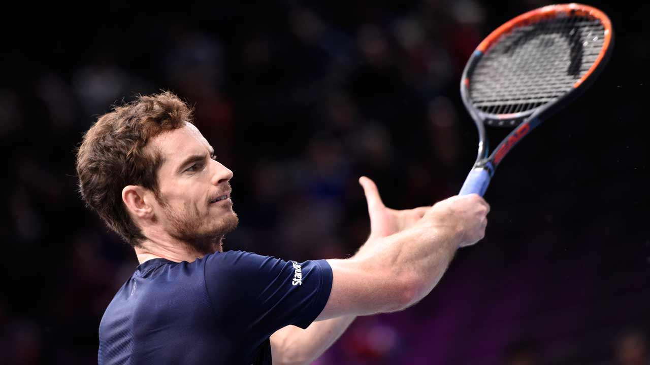 Britain's Andy Murray warms up before his semi-final tennis match at the ATP World Tour Masters 1000 indoor tournament in Paris on November 5, 2016. MIGUEL MEDINA / AFP