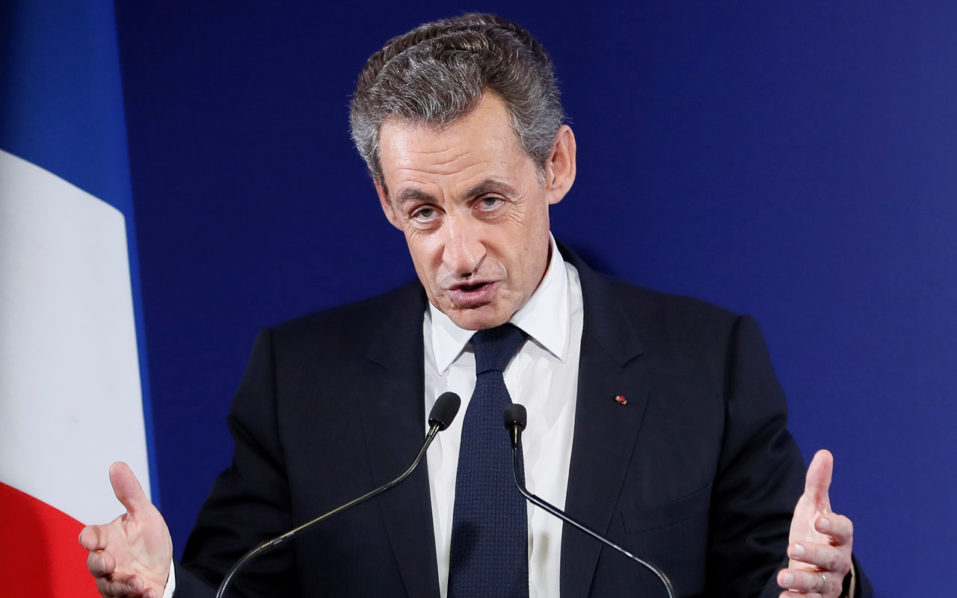 Former French President and candidate for the French right-wing presidential primary Nicolas Sarkozy delivers a speech at his campaign headquarters after the vote's first round, on November 20, 2016 in Paris. Francois Fillon took a commanding lead in the two-round primary that is widely expected to decide the country's next leader. In a major upset, Fillon had more than 43 percent of the vote to 26.7 percent for former prime minister Alain Juppe and just under 23 percent for Nicolas Sarkozy, according to the official tallies. / AFP PHOTO / POOL / IAN LANGSDON