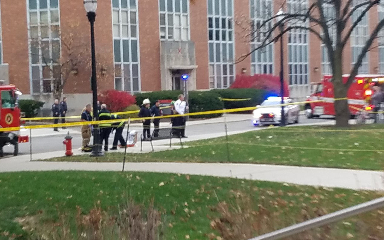 """Photo courtesy the student daily of the Ohio State University (OSU)""""The Lantern"""", obtained November 28, 2016 shows police securing an area on the OSU campus in Columbus, Ohio. Authorities lifted the lockdown at Ohio State University where eight people were injured in an apparent shooting, declaring the incident over. / AFP PHOTO / The Lantern / Handout /"""