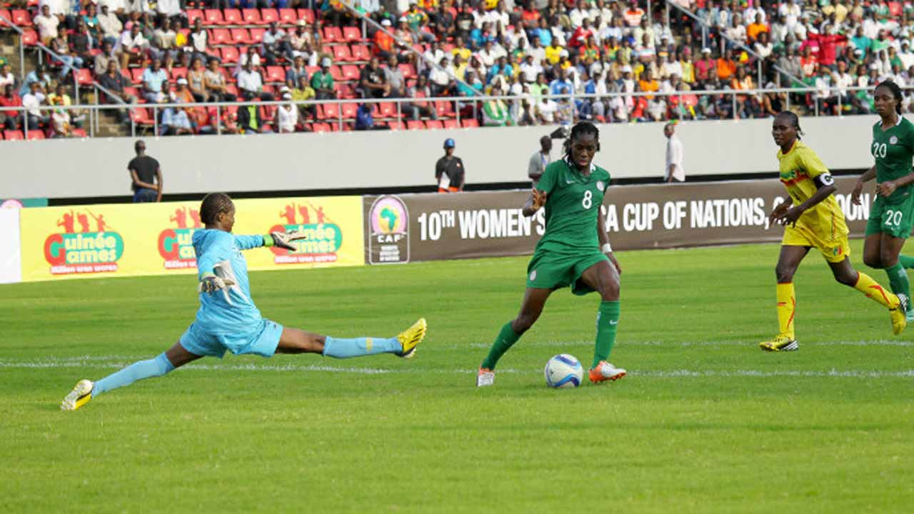 Super Falcons' star, Asisat Oshoala (right) skips past Mali's goalkeeper, Goundo Samake, to score one of his four goals in Nigeria's 6-0 demolition of their West African neighbours… on Sunday. PHOTO: CAF.