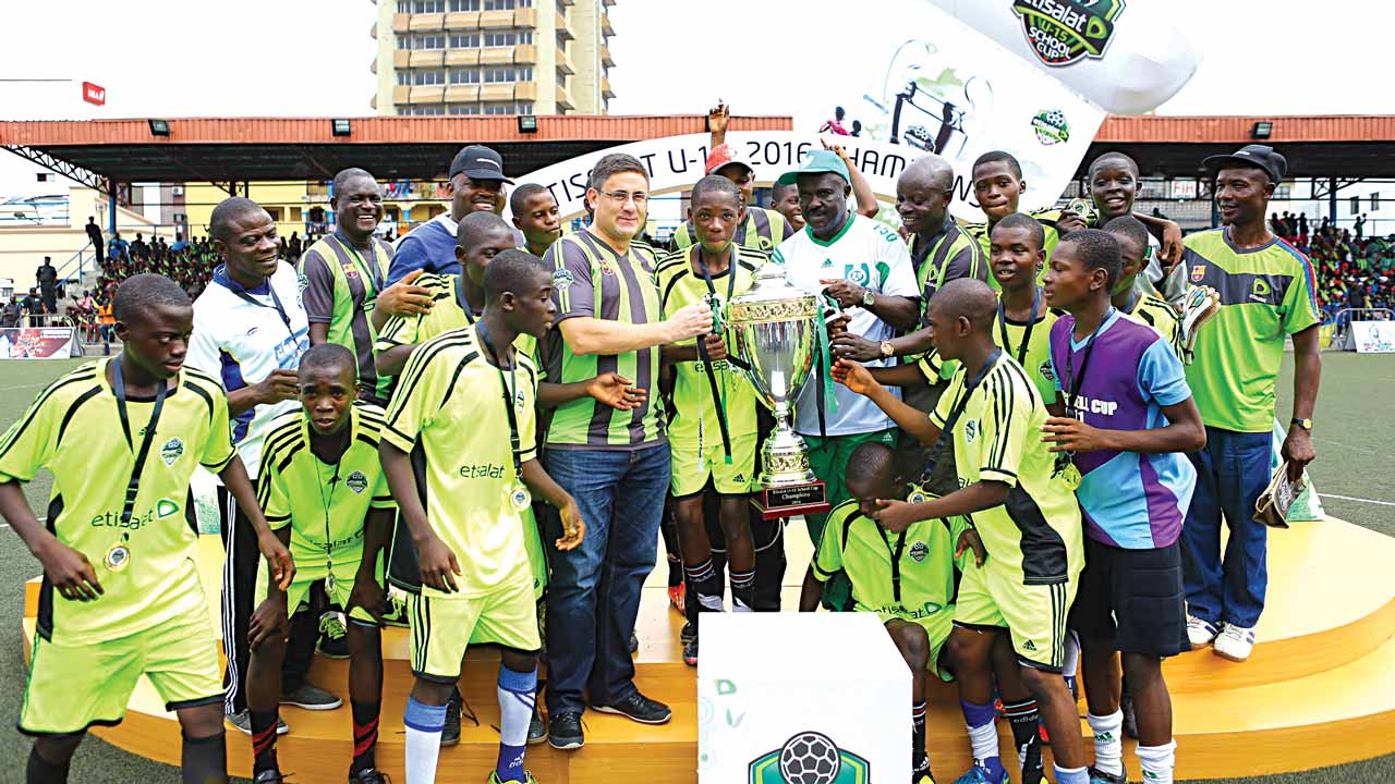 Director General, Lagos State Sports Commission, Adewunmi Ogunsanya (left); Chief Executive Officer, Etisalat Nigeria, Matthew Willsher; Captain of Asegun Comprehensive High School U-15 School Team, Ajibade Kehinde and President, Nigerian School Sports Federation (NSSF), Mallam Ibrahim Muhammad during the presentation of the N2m cheque winners' prize to the school at the Etisalat U-15 School Cup Final at the Campos Mini-Stadium, Lagos… on Saturday.