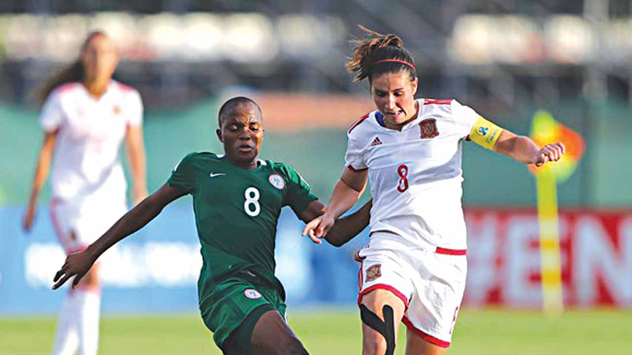 Nigeria's Rasheedat Ajibade (left) battles with a Spanish player during their FIFA U-20 Women World Cup match in Papua New Guinea…yesterday. PHOTO: NFF