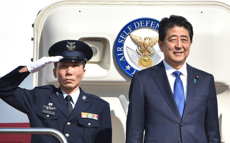 Japan's Prime Minister Shinzo Abe (R) leaves Tokyo's Haneda Airport on November 17, 2016. Abe headed to New York on November 17 for talks with Donald Trump, the first leader to meet with the president-elect whose campaign pledges provoked anxiety over US foreign policy. / AFP PHOTO / KAZUHIRO NOGI
