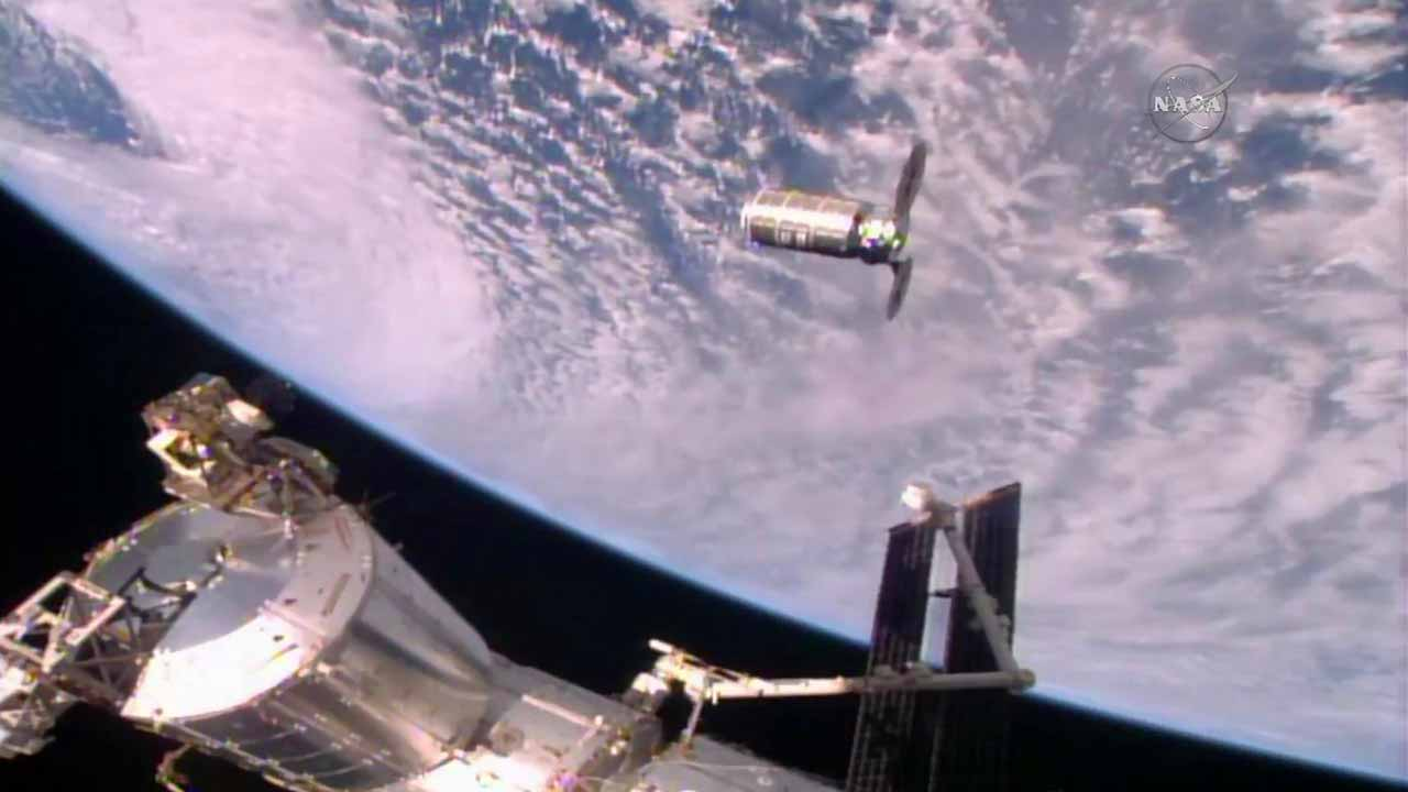 (FILES) This file photo taken on October 23, 2016 and obtained courtesy of NASA TV shows the Cygnus cargo ship slowly approaching the International Space Station (ISS) for docking. How does fire act in space? Researchers will soon find out by trying to ignite nine different materials aboard the unmanned spaceship on its way to a fiery re-entry into Earth's atmosphere, NASA said Monday, November 21, 2016. The fire experiment is the second of its kind aboard a Cygnus cargo ship operated by the US company Orbital ATK. The first experiment took place in June. HO / NASA TV / AFP