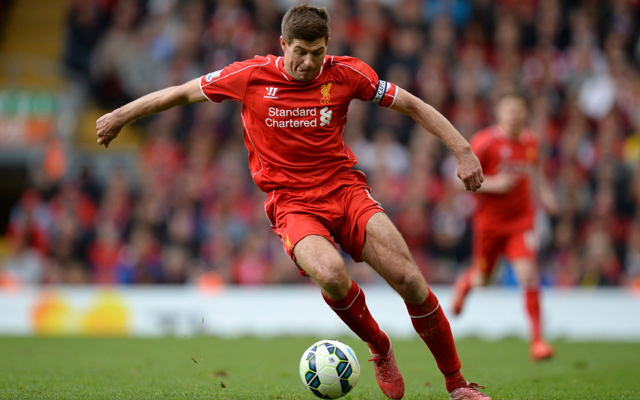 Liverpool's English midfielder Steven Gerrard runs with the ball during the English Premier League football match between Liverpool and Crystal Palace at the Anfield stadium in Liverpool, northwest England. Former Liverpool and England captain Steven Gerrard announced his retirement from professional football on November 26, 2016, at the age of 36, calling time on an emblematic career. Gerrard spent 17 years at his home-town club Liverpool, 12 as captain, and won seven major honours including the 2005 Champions League before finishing his career with an 18-month stint at LA Galaxy. / AFP PHOTO / Oli SCARFF /