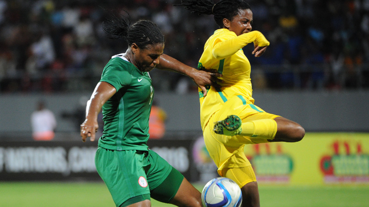 Bambanani Mbane of South Africa challenges Ugochi Desire Oparanozie  of Nigeria  during the Women Africa Cup of Nations match between Nigeria and South Africa  29 November 2016 at Limbe Omnisports Stadium. PHOTO: Sydney Mahlangu/ BackpagePix