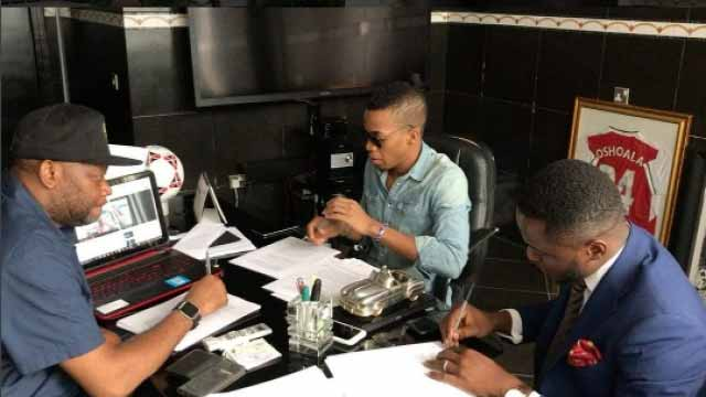 Paul Okoye (left), Tekno (middle) and Ubi Franklin during the signing of the contract