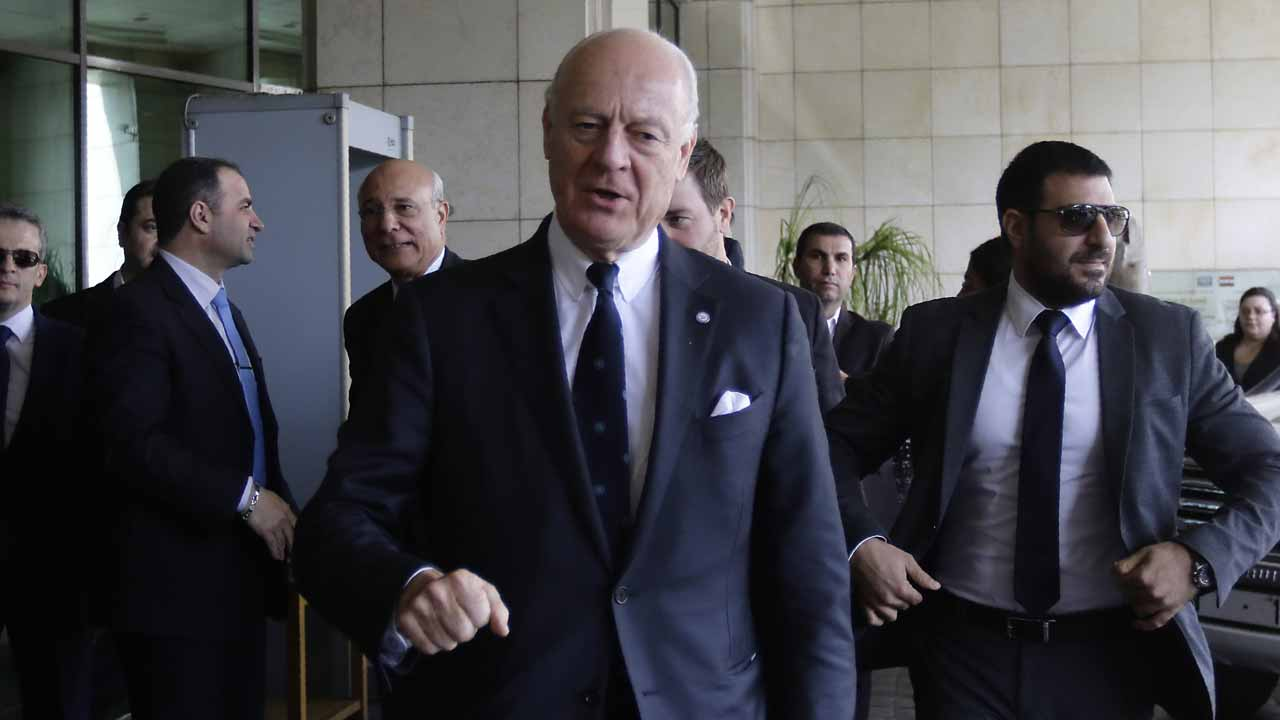 UN Syria envoy Staffan de Mistura arrives (C) arrives for a meeting with Syrian Foreign Minister in the capital Damascus, on November 20, 2016. Syria's government pounded rebel-held Aleppo with fresh fire on November 19, raising the civilian toll over 100 in under a week, as the UN's envoy arrived in Damascus for talks. LOUAI BESHARA / AFP