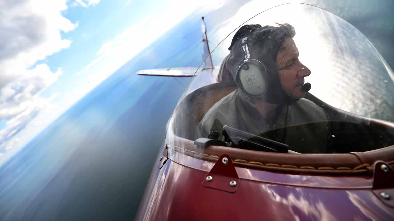 (FILES) This file photo taken on October 10, 2016 shows Pilot Pedro Langdon flying his Travel Air 4000 biplane during a photocall for the launch of the Vintage Air Rally in Shoreham, Sussex. Pilots taking part in a vintage air rally across Africa were being detained on November 23 by Ethiopian authorities, a spokesman for the trip said. BEN STANSALL / AFP
