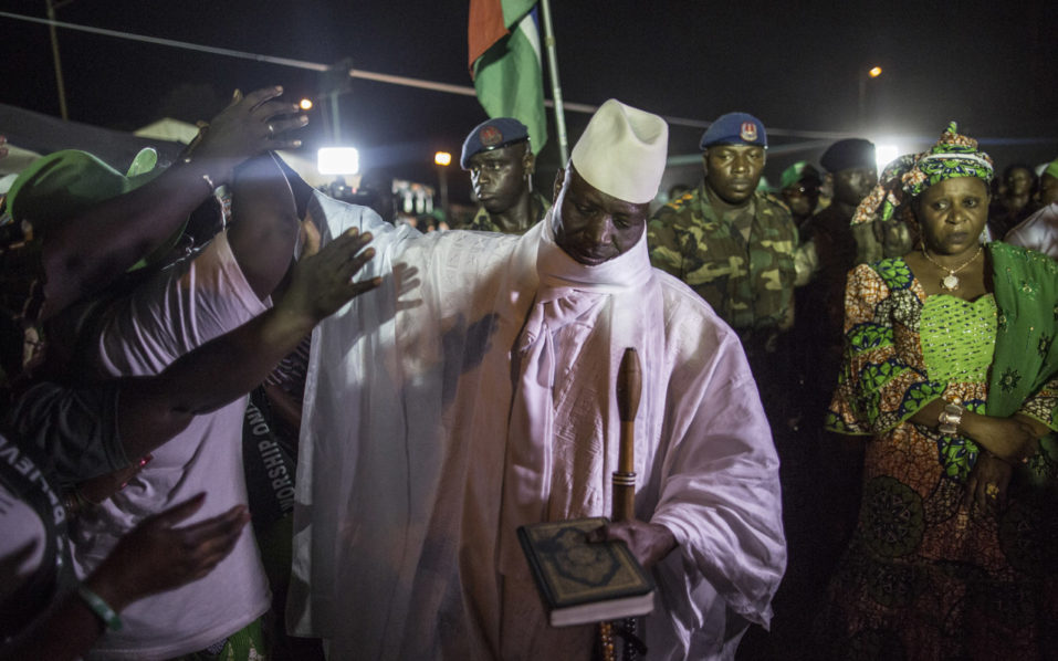 Incumbent Gambian President Yahya Jammeh, leader of the APRC (The Alliance for Patriotic Reorientation and Construction) greets his suporters in Bikama on November 24, 2016 during an electoral rally. As electoral favorite Jammeh seeks his fifth term in power, a two-week campaign period will come to an end next week ahead of the December 1st presidential election with political leaders canvassing in rural areas. / AFP PHOTO / MARCO LONGARI