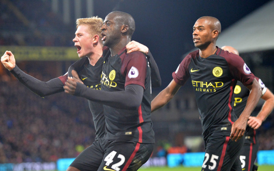 Manchester City's Ivorian midfielder Yaya Toure (C) celebrates with Manchester City's Belgian midfielder Kevin De Bruyne (L) and Manchester City's Brazilian midfielder Fernandinho (R) after scoring their second goal during the English Premier League football match between Crystal Palace and Manchester City at Selhurst Park in south London on November 19, 2016. Manchester City won the game 2-1. / AFP PHOTO / OLLY GREENWOOD / RESTRICTED TO EDITORIAL USE. No use with unauthorized audio, video, data, fixture lists, club/league logos or 'live' services. Online in-match use limited to 75 images, no video emulation. No use in betting, games or single club/league/player publications.  /