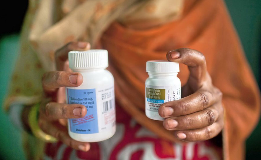 A file picture taken on HIV-infected women posing with her antiretroviral drugs at her home. Photo: AFP/Andrew Caballero-Reynolds