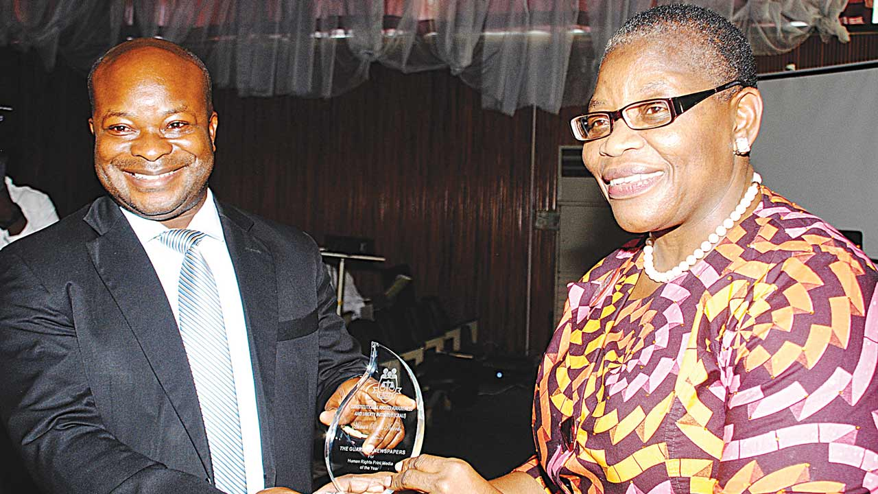 Assistant Judicial Editor of The Guardian Newspapers Limited, Joseph Onyekwere (left) receiving the Human Rights Print Media Award from the keynote speaker, Oby Ezekwesili during the National Human Rights Conference in Lagos…yesterday PHOTO: OSENI OLADELE YUSUF