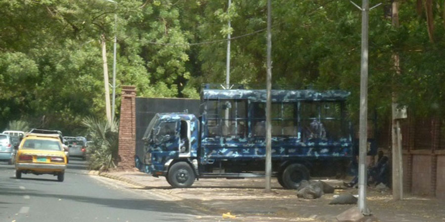 Riot police stand guard outside the University of Khartoum following an earlier demonstration Ian Timberlake (AFP)