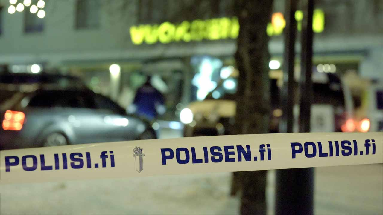 Police officers investigate the area where three women were killed in a restaurant in Imatra, Eastern Finland on December 4, 2016. A gunman shot dead three women, including a local council official, as they were leaving a restaurant in a small Finnish town on Saturday night, police said. PHOTO: Hannu RISSANEN / Lehtikuva / AFP