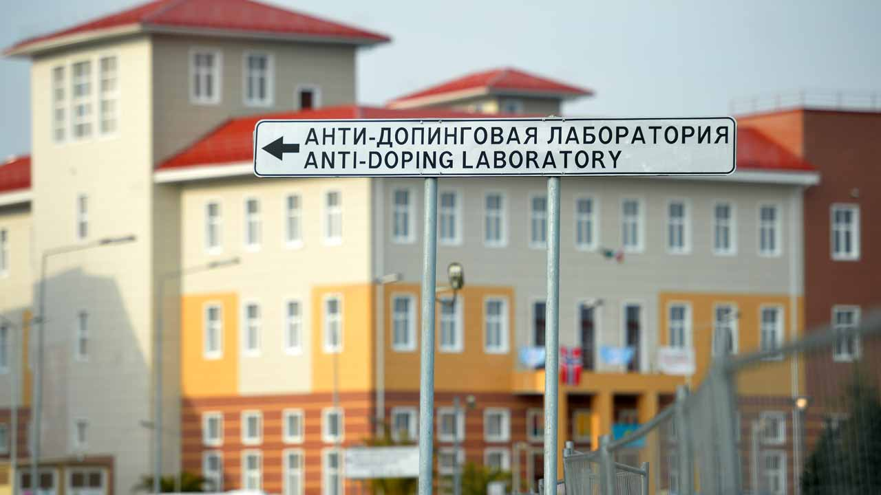 (FILES) This file photo taken on February 21, 2014 at the Olympic Park in Sochi shows a sign showing the direction to the anti-doping laboratory of the 2014 Winter Olympic Games. Salt and coffee were used to conceal positive drug tests by Russian athletes, doping investigator Richard McLaren revealed on December 9, 2016. Former Moscow doping laboratory director Grigory Rodchenkov swapped positive urine samples with previously collected clean samples, adding salt and coffee to replicate the consistency of the original samples. PHOTO: LEON NEAL / AFP