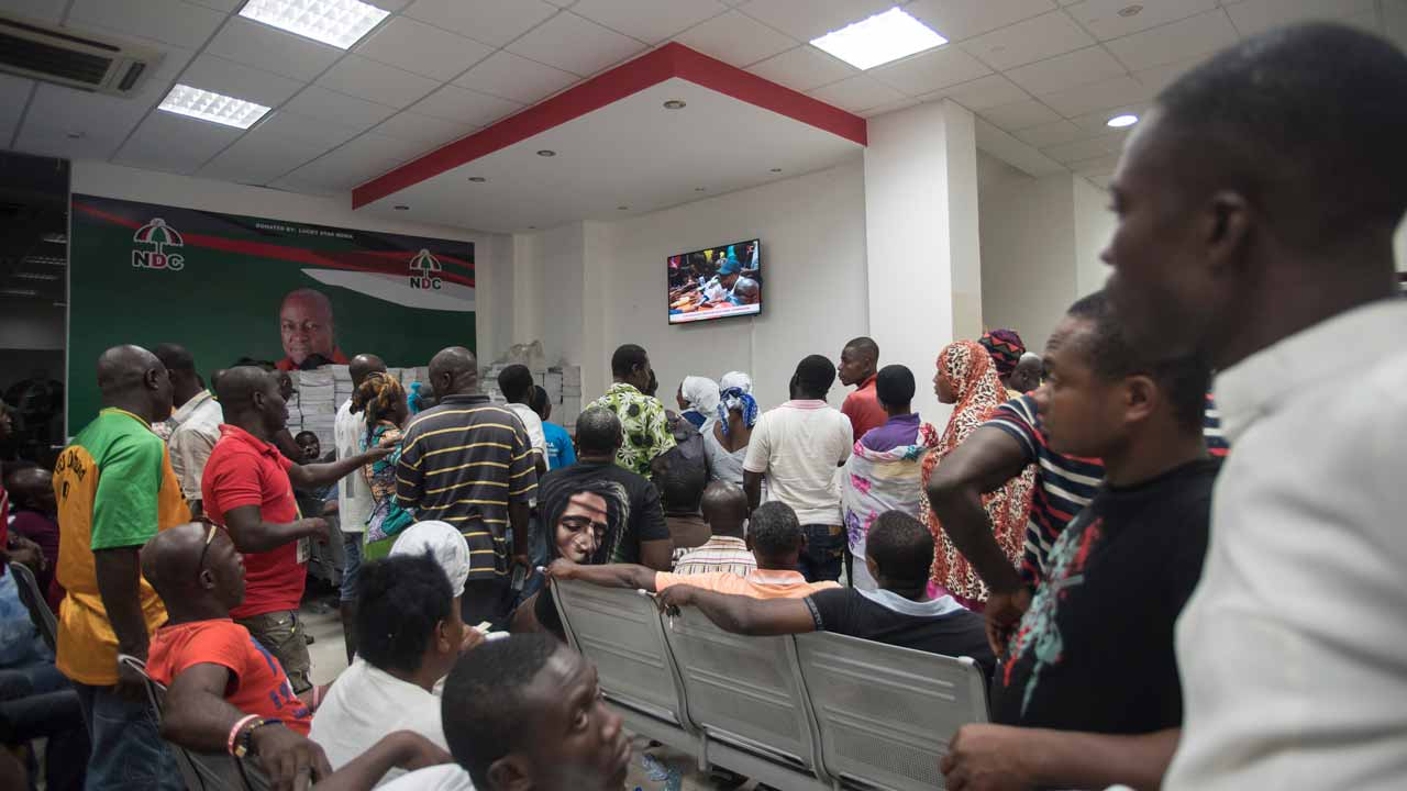 Supporters of National Democratic Congress watch the electoral results at NDC central headquarters in Accra on December 9, 2016 two days after a hotly contested election, seen as a test for a country generally viewed as a beacon of stability in west Africa. Mahama called to congratulate opposition leader Nana Akufo-Addo, whose supporters had already gathered outside his modest house as media had given him a clear lead after December 7 polls. PHOTO: CRISTINA ALDEHUELA / AFP