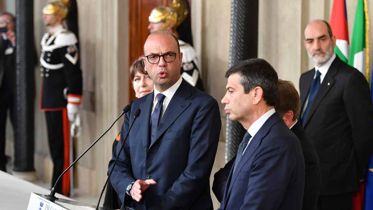 Angelino Alfano (L), Interior Prime Minister and leader of the New Center Right party speaks flanked by delegate of centre-right and mainly Christian-democratic coalition Area Popolare (NCD-UDC), Maurizio Lupi (C) during a press point following a meeting with Italy's President Sergio Mattarella on December 10, 2016 at the Quirinale Palace in Rome. Representatives of Italy's main parties are headed to the presidential palace, their task to agree on a new government made even more urgent by fears of a banking crisis in the eurozone's third-largest economy. Italy was plunged into political uncertainty by the resignation of Prime Minister Matteo Renzi following a crushing referendum defeat. PHTO: Alberto PIZZOLI / AFP