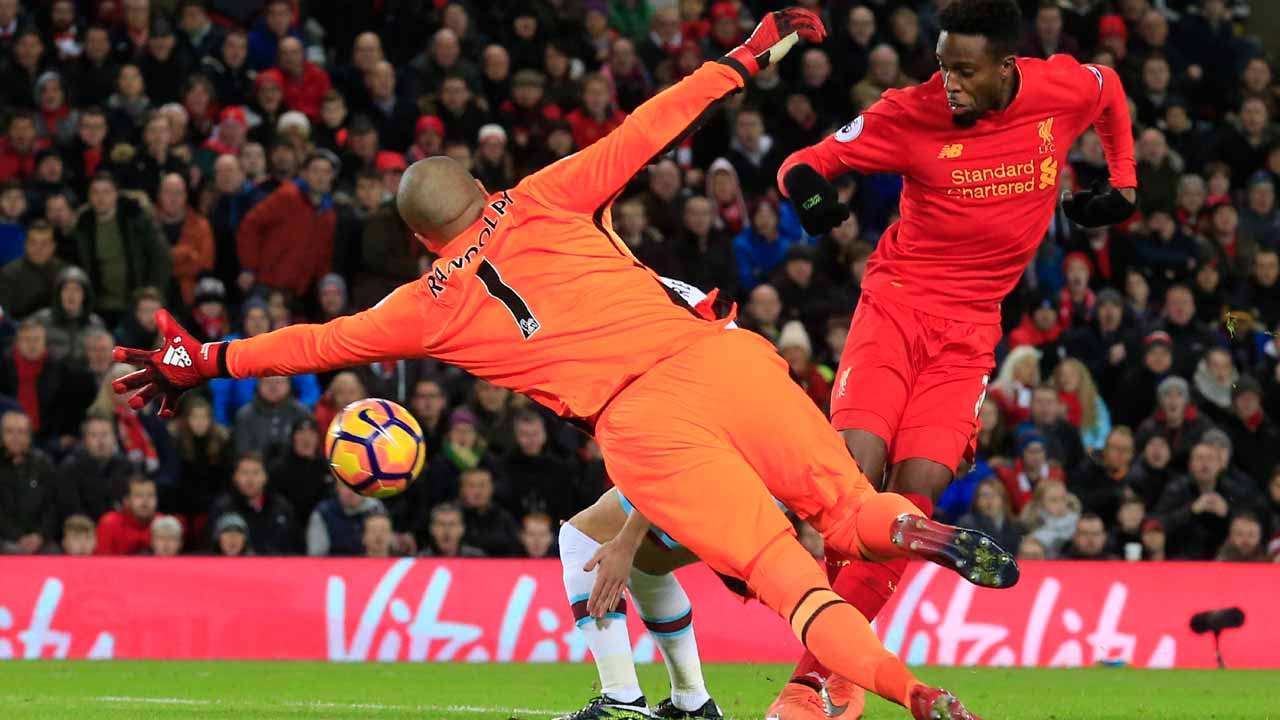 Liverpool's Belgian striker Divock Origi (R) scores their second goal to equalise during the English Premier League football match between Liverpool and West Ham United at Anfield in Liverpool, north west England on December 11, 2016. PHOTO: Lindsey PARNABY / AFP