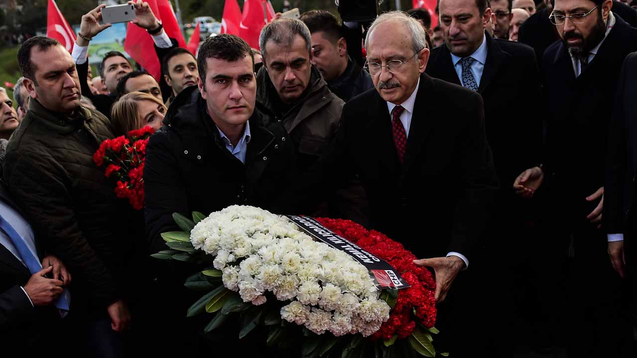 Kemal Kilicdaroglu (C-R), leader of the Republican People's Party (CHP), lays flowers at the scene of December 10 blasts outside the Vodafone Arena football stadium on December 14, 2016 in Istanbul. The death toll from the Istanbul twin bombings near a major football stadium has risen to 44, Turkish Health Minister Recep Akdag said on December 12, 2016. PHOTO: YASIN AKGUL / AFP
