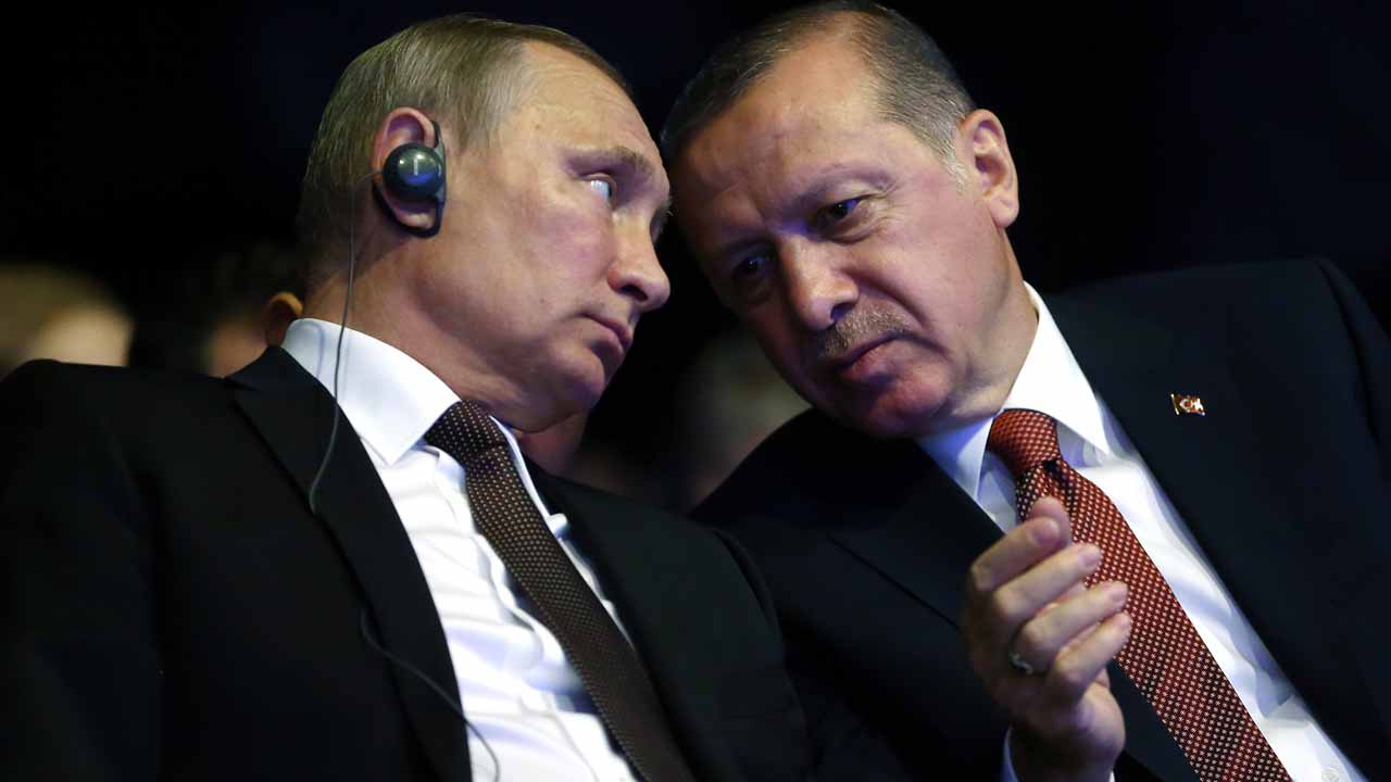 "(FILES) This file photo taken on October 10, 2016 shows Turkish President Recep Tayyip Erdogan (R) talking with his Russian counterpart Vladimir Putin during the opening ceremony of the 23rd World Energy Congress in Istanbul, Turkey. Turkish President Recep Tayyip Erdogan and his Russian counterpart Vladimir Putin agreed on December 14, 2016 in a phone call that violations of a ceasefire deal agreed for the Syrian city of Aleppo should stop, Turkish presidential sources said. ""In the phone call, they stressed that the ceasefire agreement secured yesterday night should be put into practice (and) the violations of the deal must be stopped,"" the sources said. PHOTO: KAYHAN OZER / TURKISH PRESIDENTIAL PRESS OFFICE / AFP"