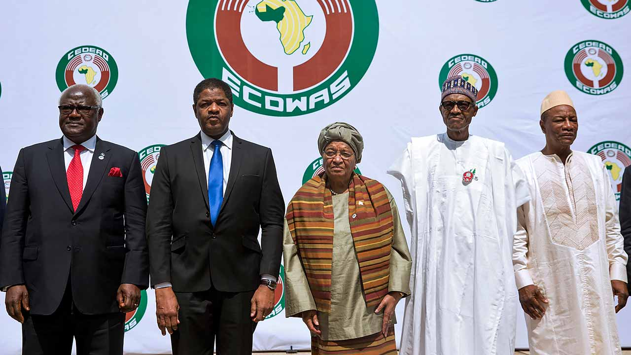 (From L) Sierra Leon's President Ernest Bai Koroma, President of ECOWAS official Marcel Alain de Souza, Liberian President and Ecowas Chairperson Ellen Johnson Sirleaf, Nigerian President Muhammadu Buhari (R) and Guinean President Alpha Conde (C) pose during the 50th summit of the 15-member Economic Community of West African States (ECOWAS) in Abuja, on December 17, 2016. West African leaders called today for a swift resolution of the political impasse in The Gambia after disputed elections in which long-term president Yahya Jammeh is refusing to concede defeat. The appeal came at the 50th summit of the 15-member Economic Community of West African States (ECOWAS) in Nigeria, attended by 11 heads of state but without the leaders of four members including The Gambia. PHOTO: Pius Utomi EKPEI / AFP