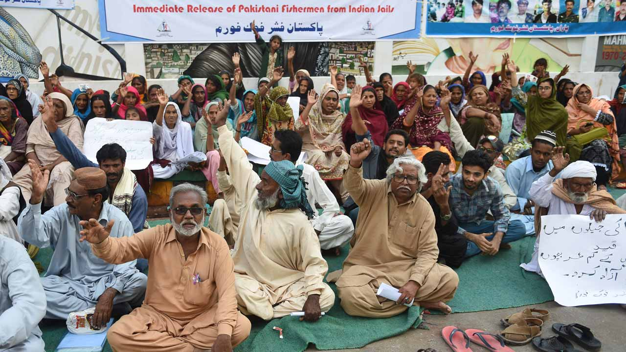 Family members of Pakistani fishermen arrested by Indian authorities protest in Karachi on December 24, 2016, demanding their release. Fishermen from both sides often end up spending years in each other's jails before being set free and sent home, because fulfilling legal formalities takes a long time due to poor diplomatic ties between the two arch-rivals. PHOTO: RIZWAN TABASSUM / AFP