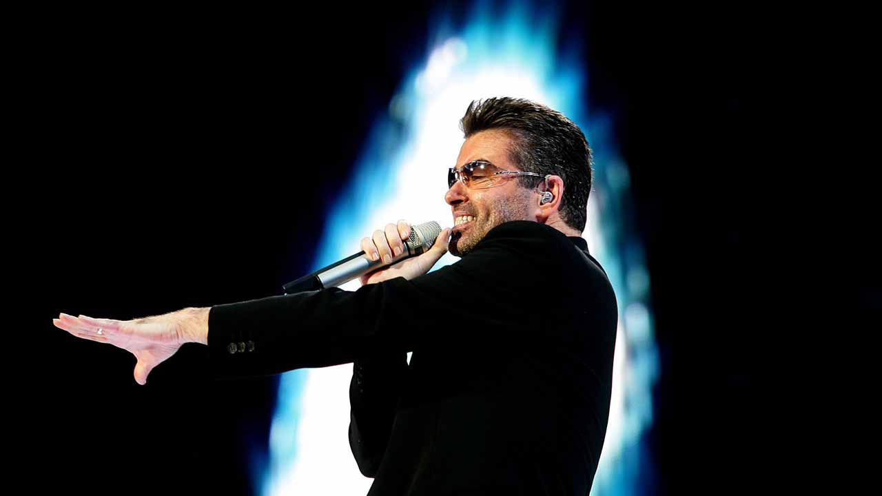 "(FILES) This file photo taken on June 26, 2007 shows British singer George Michael performing during a concert in Amsterdam. British pop star George Michael, who rose to fame with the band Wham! and sold more than 100 million albums in his career, has died aged 53, his publicist said on December 25, 2016. ""It is with great sadness that we can confirm our beloved son, brother and friend George passed away peacefully at home over the Christmas period,"" the publicist said in a statement. PHOTO: EVERT ELZINGA / ANP / AFP"