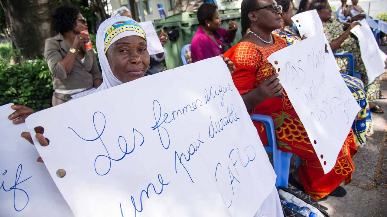 "Some ten women hold up placards one that reads, ""Women require stable peace"" as they rally in the grounds of the compound of the inter diocesan centre where negotiations are taking place led by the Congolese episcopate on December 30, 2016 in Kinshasa as President Joseph Kabila refuses to step down at the end of his December 20 mandate. DR Congo's government and the opposition are ""on the verge"" of concluding an accord to end a political crisis over President Joseph Kabila's refusal to quit power, the influential Catholic Church said on December 30. The informal talks between the foes, mediated by the Catholic Church since December 8, resumed after a Christmas break. The two sides ""are on the verge of concluding an accord,"" said Marcel Utembi, president of the CENCO, who had pushed for a deal earlier. PHOTO: JUNIOR D.KANNAH / AFP"