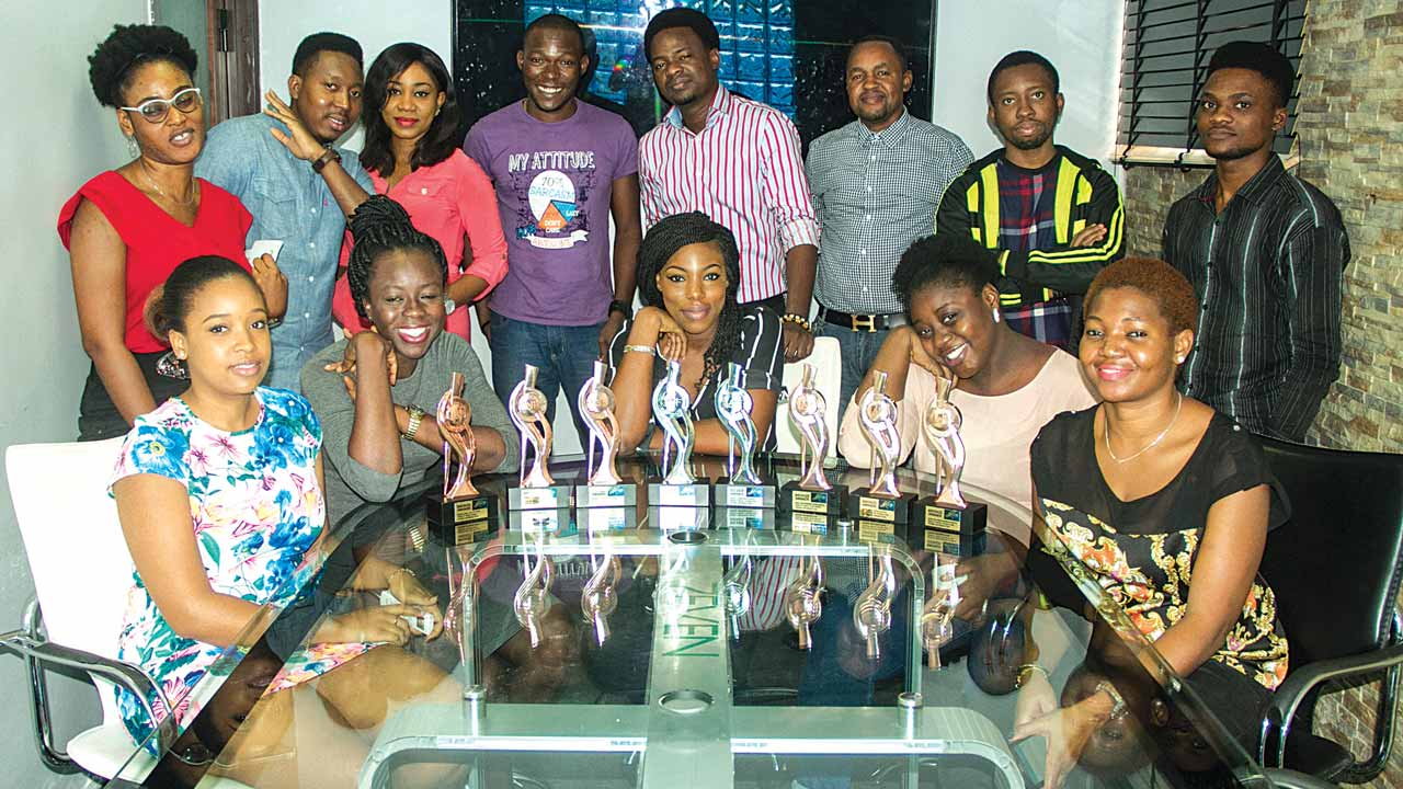 A cross section of 7even interactive staff with the awards