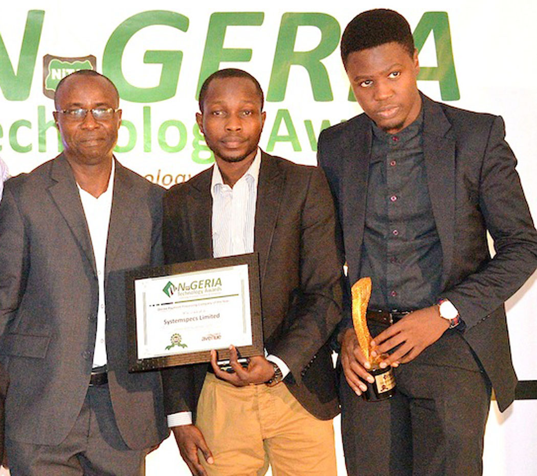 L-R: CEO, Peace Consult Ltd, Mr. Ufot E. Ufot presenting the Best Online Payment Processing Company of the Year award to Social Media Executive, SystemSpecs, Adewale Adetana and Brand/Events Executive, Systemspecs Damilola Ogundipe,during the 2nd edition of the Nigeria Technology Award ceremony in Lagos recently PHOTO: ETOP UKUTT