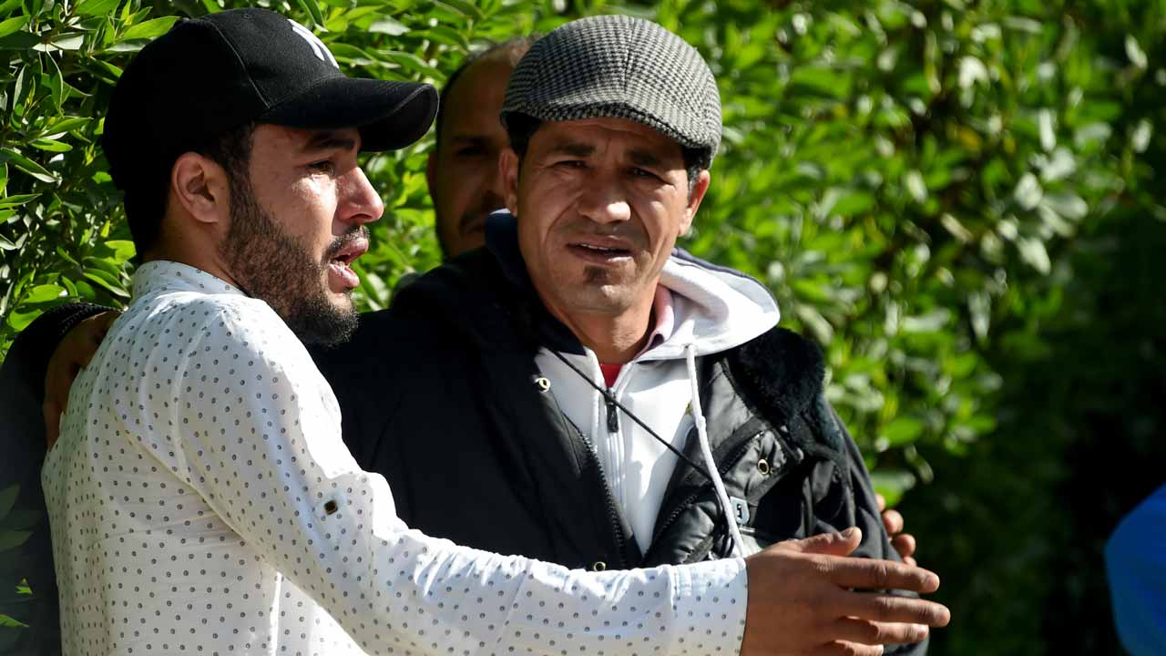 Abdelkader Amri (L), one of the brothers of 24-year-old Anis Amri, the prime suspect in Berlin's deadly truck attack, talks to the media in front of their family house in the town of Oueslatia, in Tunisia's region of Kairouan on December 22, 2016. German authorities came under fire after it emerged that the prime suspect in Berlin's deadly truck attack, a rejected Tunisian asylum seeker, was known as a potentially dangerous jihadist. FETHI BELAID / AFP