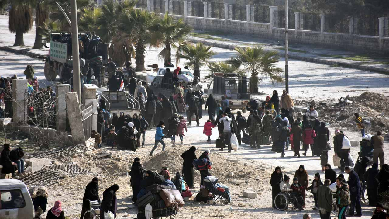 Syrian civilians arrive at a checkpoint manned by pro-government forces, at the al-Hawoz street roundabout, after leaving Aleppo's eastern neighbourhoods on December 10, 2016. Syria's government has retaken at least 85 percent of east Aleppo, which fell to rebels in 2012, since beginning its operation on November 15. George OURFALIAN / AFP