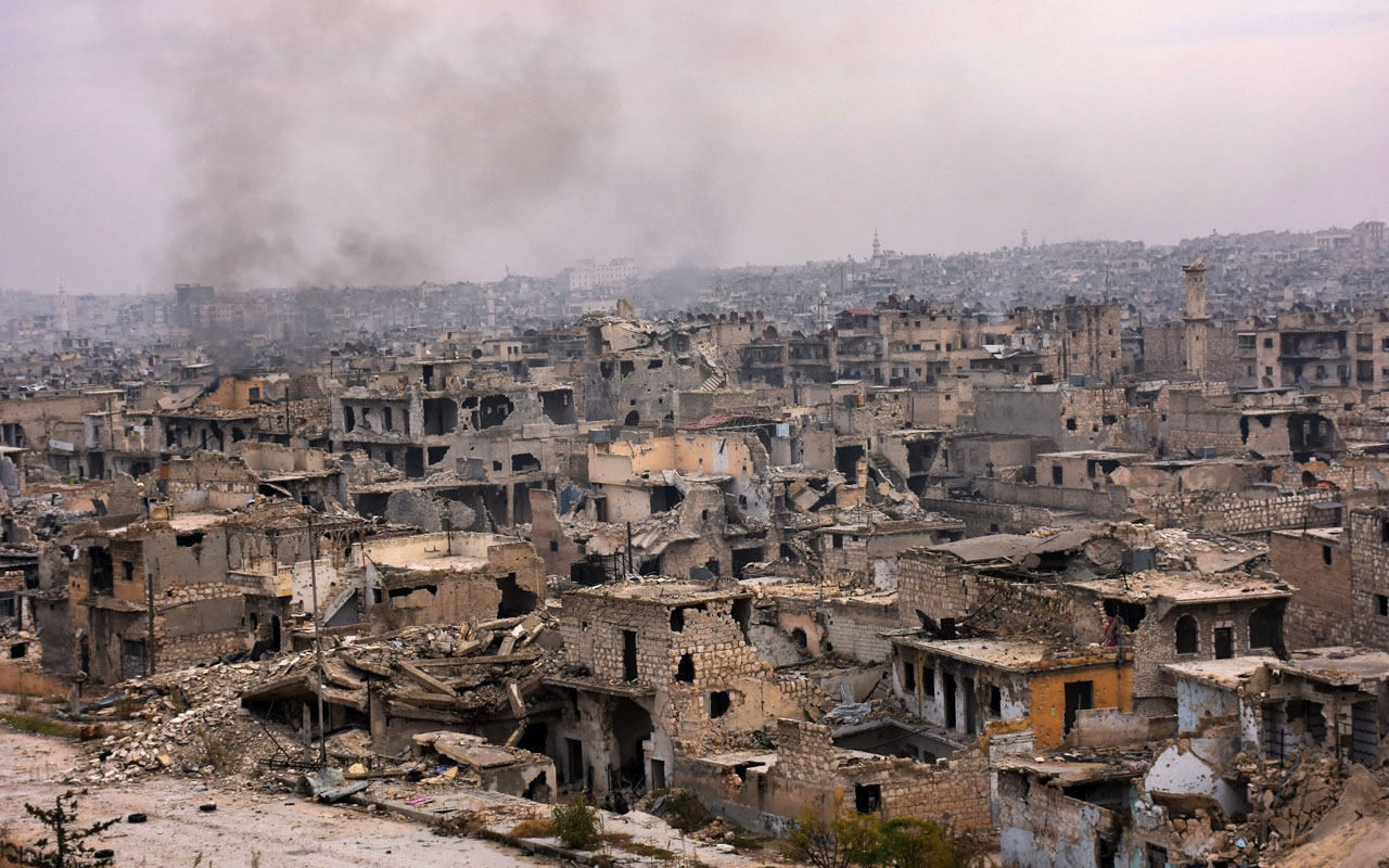 A picture taken on December 5, 2016 shows destroyed buildings in Aleppo's eastern al-Shaar neighbourhood as Syrian pro-government troops advance towards the area through Karm al-Jabal district during their offensive to retake Syria's second city. The Syrian Observatory for Human Rights said the advances of the Syrian and allied forces left the large Shaar neighbourhood encircled by government forces and in danger of falling from rebel control. With the capture of Shaar, the army would hold 70 percent of east Aleppo, four years after rebels first seized it. / AFP PHOTO / GEORGE OURFALIAN /
