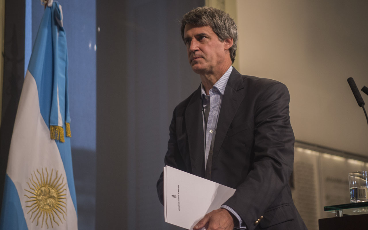 (FILES) This file photo taken on April 19, 2016 shows Finance Minister Alfonso Prat-Gay after giving a press conference at Casa Rosada Government Palace in Buenos Aires. Argentina's President Mauricio Macri asked Prat-Gay for his resignation on December 26, 2016 due to political differences. / AFP PHOTO / EITAN ABRAMOVICH