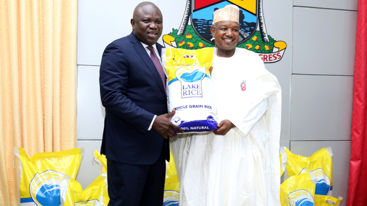 Lagos State Governor, Mr. Akinwunmi Ambode (left), with his Kebbi State counterpart, Governor Atiku Bagudu holding a 10kg of the Lake Rice during the official launch at the Banquet Hall, Lagos House, Ikeja, on Wednesday, December 21, 2016.